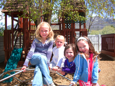 girls-on-climber-with-treehouse-web-size