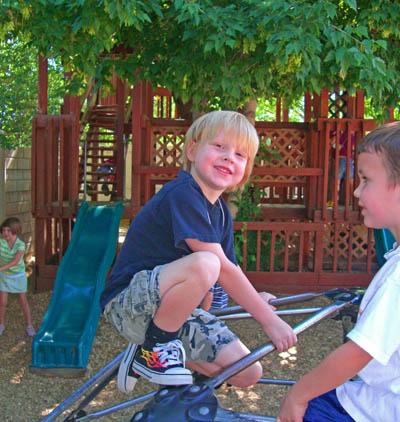 playgound-slide-show-2-boy-on-climber1-web-size