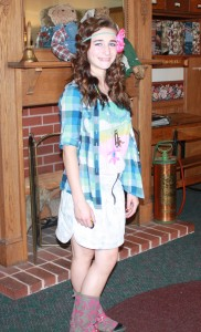 Sabrina dropped by the school to visit as a 13 year old in 2010. Surprise! She still dresses creatively. What a lovely young lady.