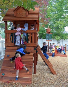 Newcastle Students run and climb on a variety of safe and fun playground structures.